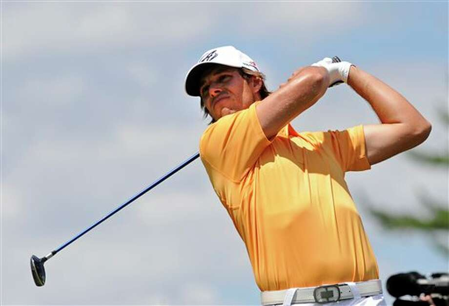 Aaron Baddeley, of Australia, watches his drive on the second hole during the final round of the TravelersChampionship golf tournament in Cromwell, Conn., Sunday, June 22, 2014. (AP Photo/Fred Beckham)
