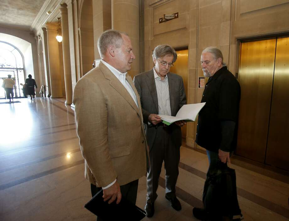 Dale Carlson (left), Doug Engmann and Calvin Welch want to have 9,700 valid signatures for their measure to curb Airbnb rentals in the city. Photo: Brant Ward, The Chronicle