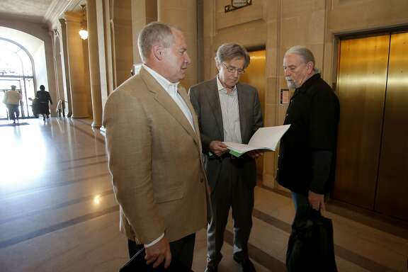 Dale Carlson (left), Doug Engmann and Calvin Welch gathered on the first floor of City Hall before going upstairs for meetings with supervisors Monday April 28, 2014. A group of neighborhood activists are organizing a ballot initiative to rein in short-term rentals like Airbnb in San Francisco, Calif.
