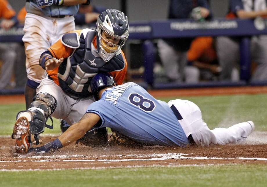 Astros catcher Carlos Corporan catches Desmond Jennings as he attempts to steal home to end the third inning. Photo: Brian Blanco, Getty Images