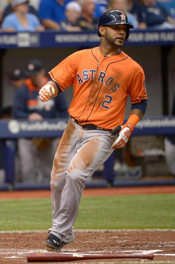 Jonathan Villar scores on Jose Altuve's single during the third inning. Photo: Phelan M. Ebenhack, Associated Press