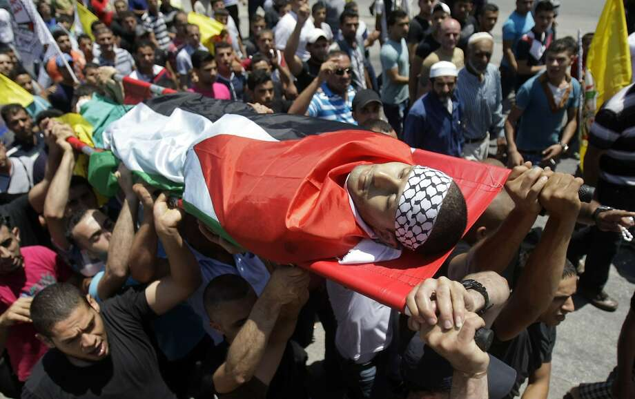 Mourners carry the body of Ahmed Saoud during his funeral in the West Bank city of Nablus. Photo: Nasser Ishtayeh, Associated Press