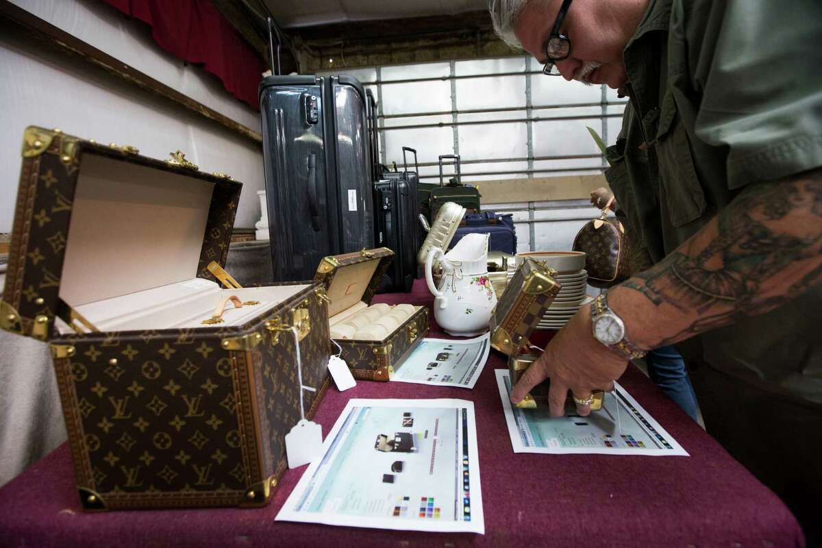 Louis Vuitton boxes are on display before an auction featuring items from the late Dr. Michael Brown's estate at Webster's Auction Palace Sunday, June 22, 2014, in Houston. The sale of his belongings are part of a bankruptcy case still in progress in U.S. District Court.