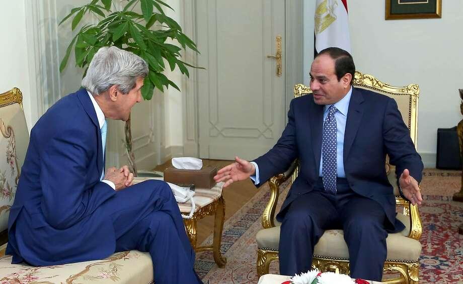 Secretary of State John Kerry (left) talks with Egyptian President Abdel-Fattah el-Sissi in Cairo. Photo: Mohammed Samaha, Associated Press