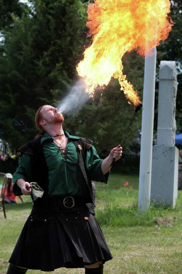 Daniel Greenwolf, of Waterbury, performs at the  Midsummer Fantasy at Warsaw Park in Ansonia, Conn. on Sunday, June 22, 2014. The faire continues for two more weekends, June 28-29 and July 5-6,  from 11:00am - 6:30pm. Photo: BK Angeletti, B.K. Angeletti / Connecticut Post freelance B.K. Angeletti