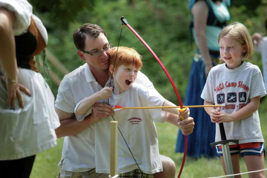 Brian More, of Southbury, and his son, Brian, 6, and daughter, Avery, 8, take turns at archery during the  Midsummer Fantasy at Warsaw Park in Ansonia, Conn. on Sunday, June 22, 2014. The faire continues for two more weekends, June 28-29 and July 5-6,  from 11:00am - 6:30pm. Photo: BK Angeletti, B.K. Angeletti / Connecticut Post freelance B.K. Angeletti