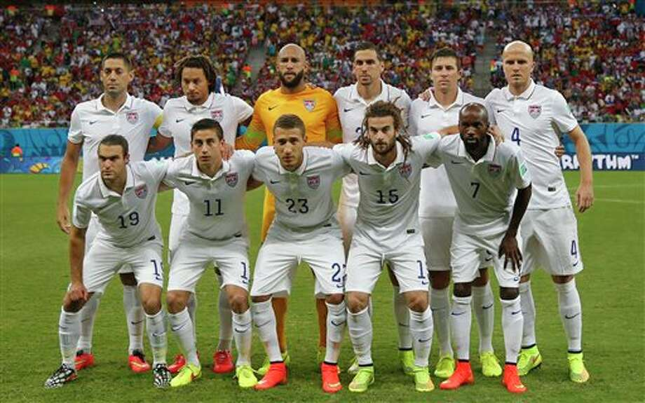 The US national team pose before the group G WorldCup soccer match between the United States and Portugal at the Arena da  Amazonia in Manaus, Brazil, Sunday, June 22, 2014. (AP Photo/Julio  Cortez)