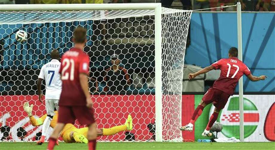 Portugal's Nani, right, scores the opening goal during the group G World Cup soccer match between the USA and Portugal at the Arena da Amazonia in  Manaus, Brazil, Sunday, June 22, 2014. (AP Photo/Paulo Duarte)