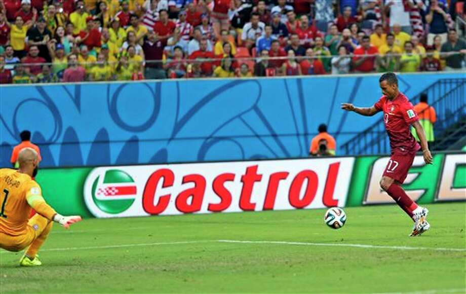 Portugal's Nani (17) takes a shot on United States' goalkeeper Tim Howard to score his side's first goal during the group G World Cup soccer match between the United States and Portugal at the Arena da Amazonia in Manaus, Brazil, Sunday, June 22, 2014.