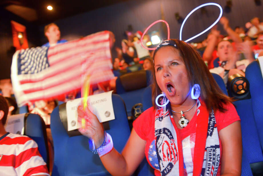 Cynthia Calzada cheers the American team  Sunday during a viewing party at Santikos Palladium IMAX Theater to watch the USA versus Portugal World Cup soccer match. Photo: Robin Jerstad