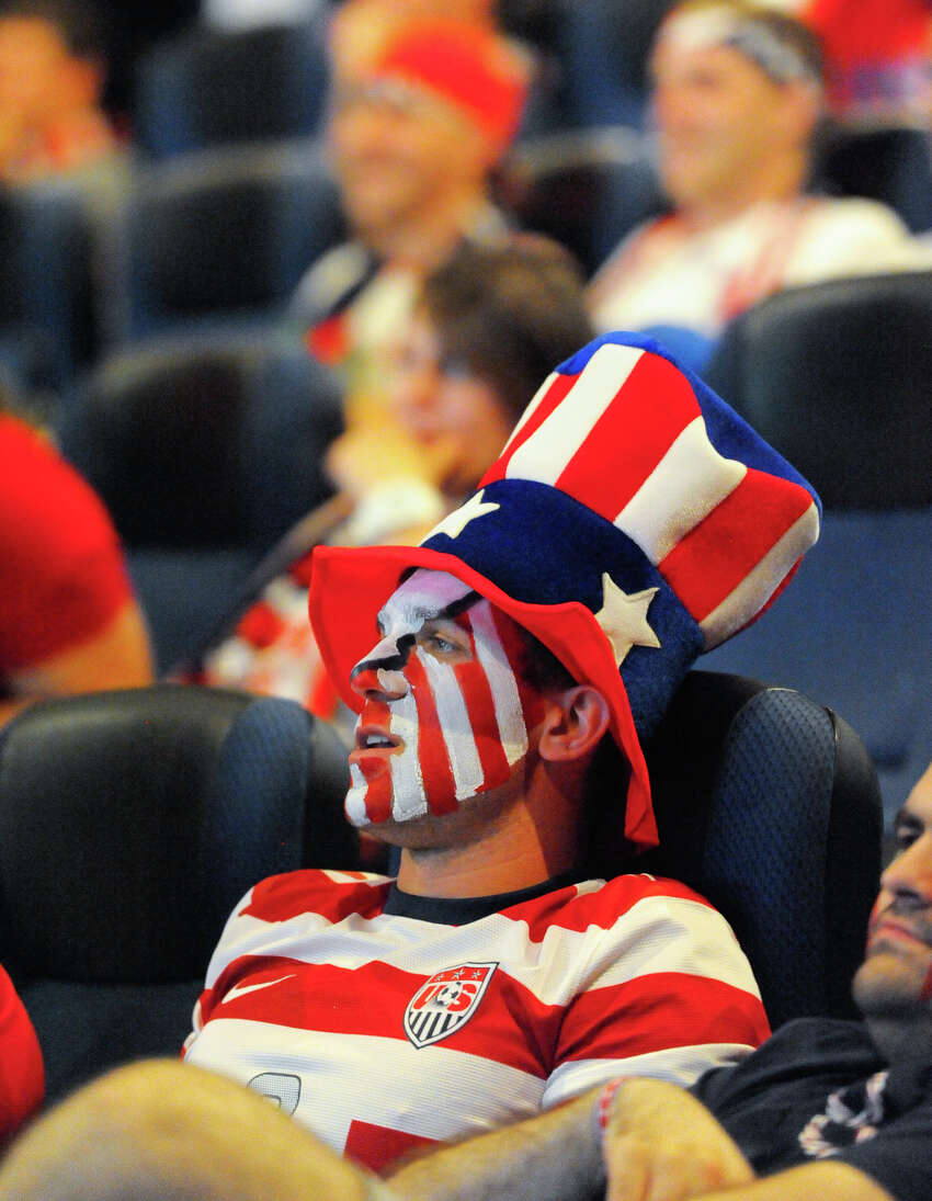 Charles Tofel is decked out in American colors Sunday during a viewing party at Santikos Palladium IMAX Theater to watch the USA versus Portugal World Cup soccer match.