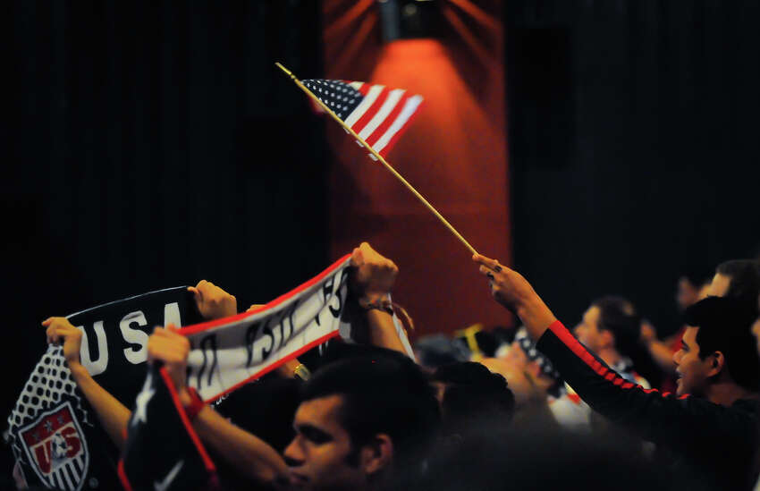 An American flag waves Sunday during a viewing party at Santikos Palladium IMAX Theater to watch the USA versus Portugal World Cup soccer match.