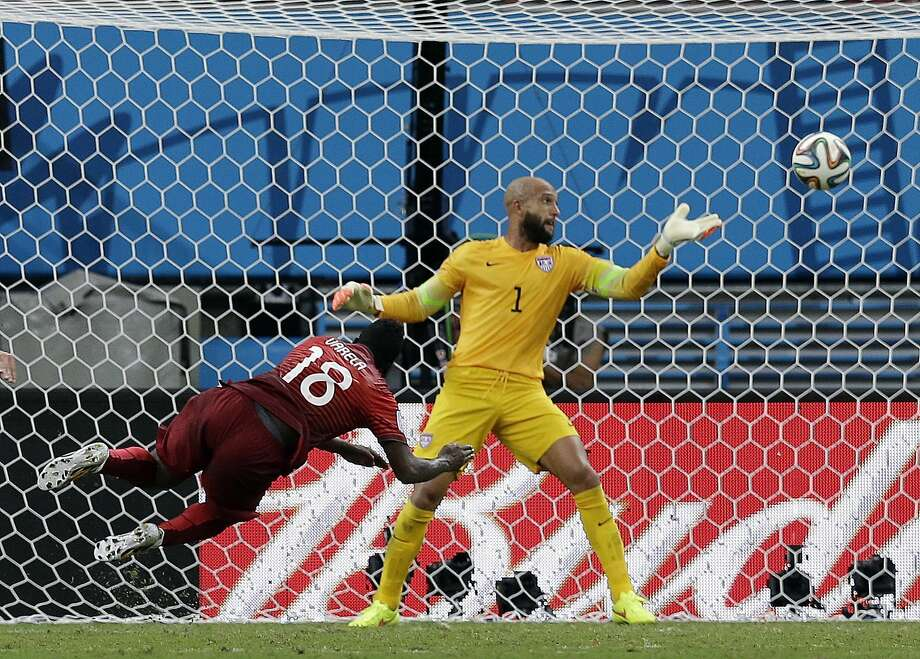 Portugal's Silvestre Varela headed the tying goal past U.S. keeper Tim Howard in extra time. The U.S. had taken a 2-1 lead in the 81st minute. Story on B7 Photo: Martin Mejia, Associated Press