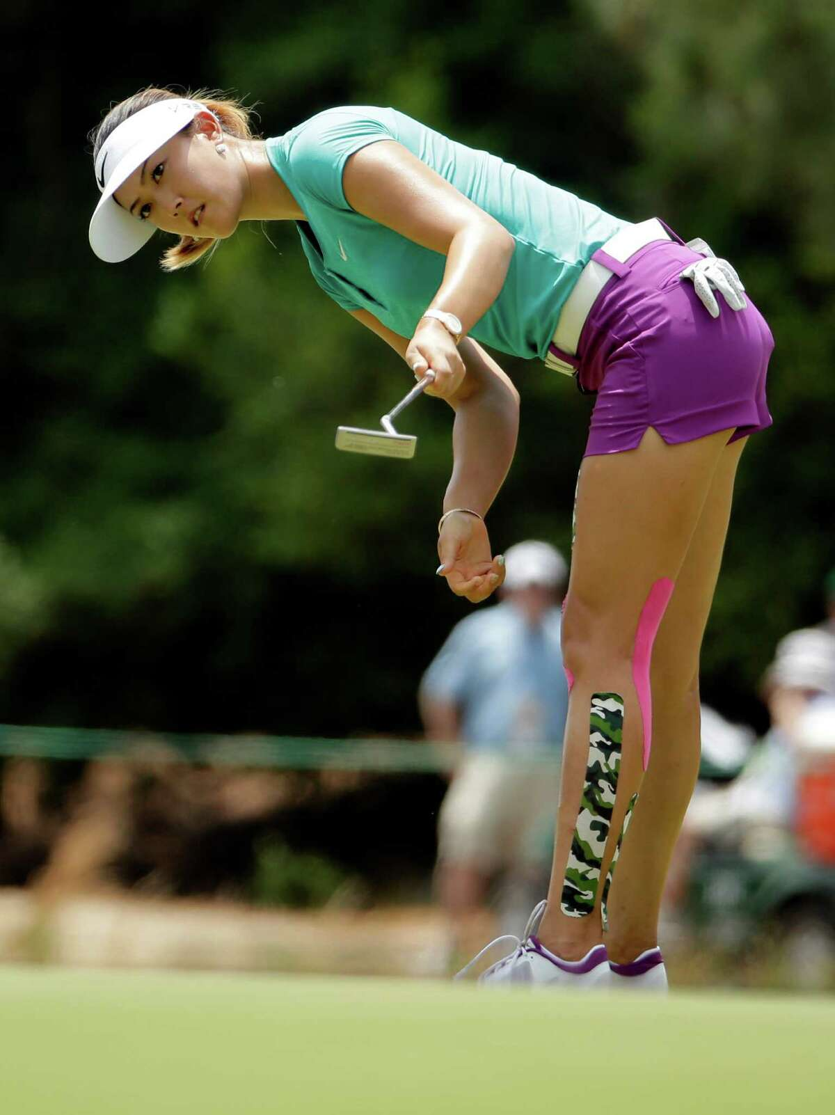 Michelle Wie reacts as she misses a putt on the second hole during the final round of the U.S. Women's Open golf tournament in Pinehurst, N.C., Sunday, June 22, 2014. (AP Photo/Chuck Burton) ORG XMIT: NCCB101