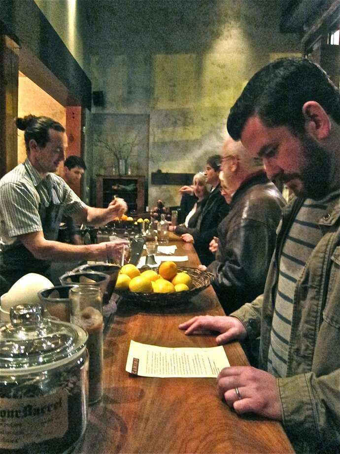 Adam Dorris checks the bar menu at Camino in Oakland, one of the inspirations for Pax Americana. Photo: Alison Cook