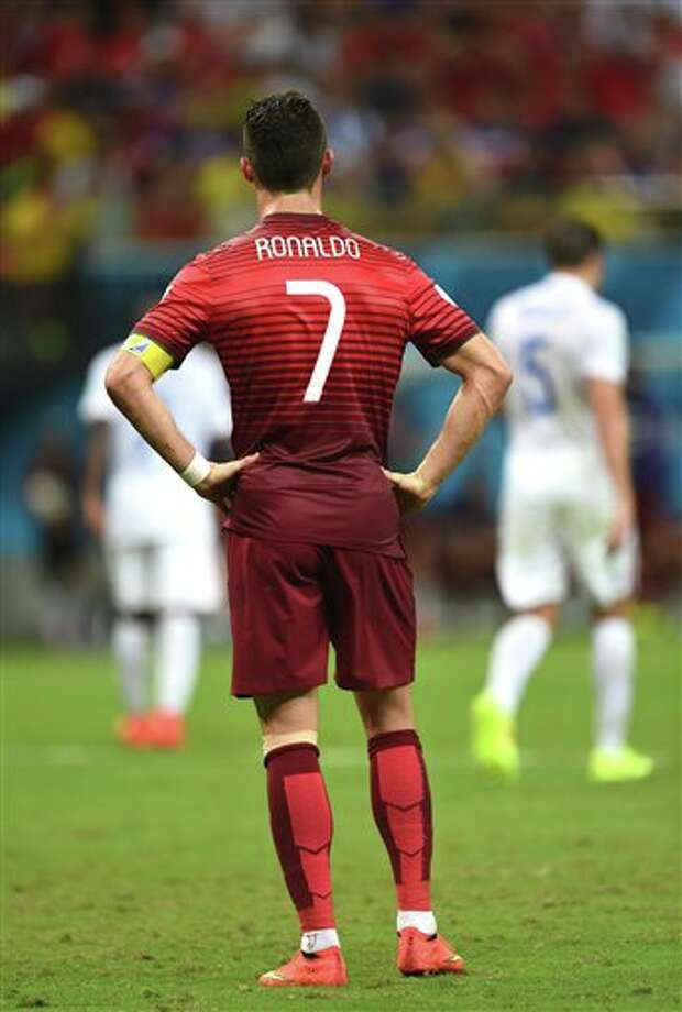Portugal's Cristiano Ronaldo stands with his hands on his hips during the group G World Cup soccer match between the USA and Portugal at the Arena da Amazonia in  Manaus, Brazil, Sunday, June 22, 2014. (AP Photo/Paulo Duarte)