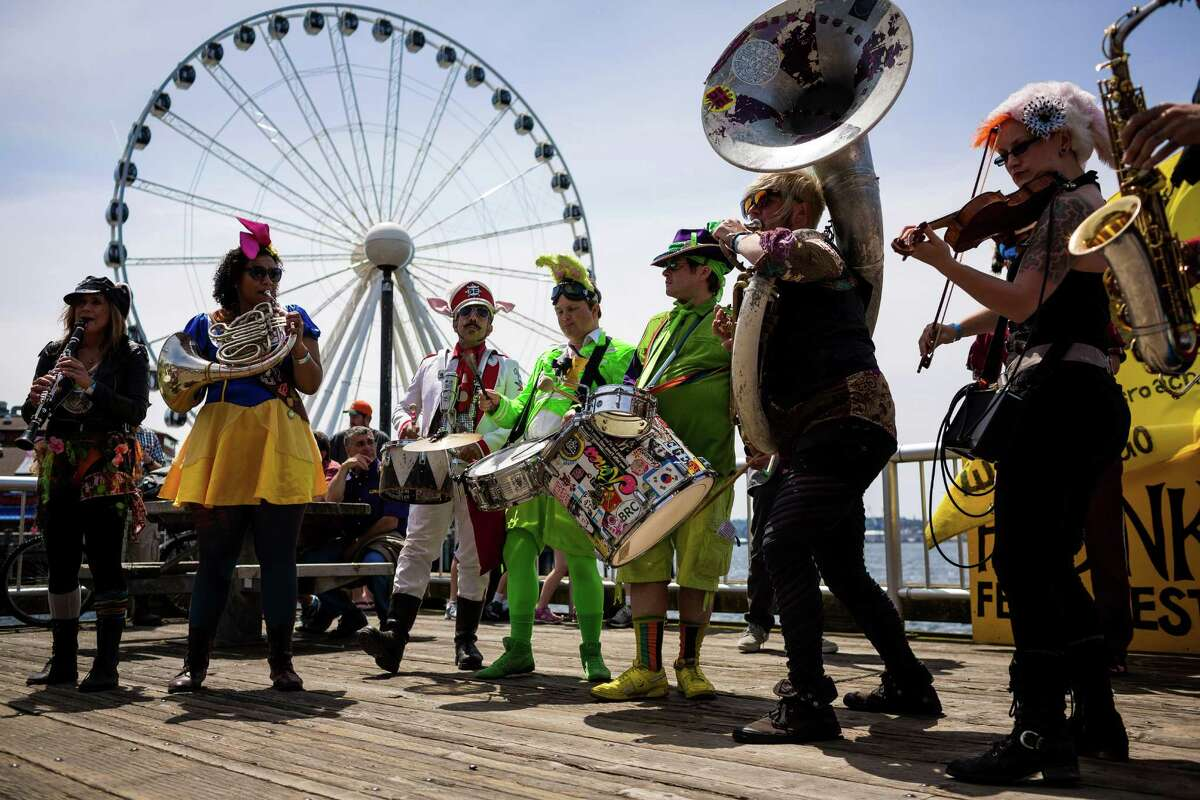 Members of Environmental Encroachment perform at the seventh annual HONK! Fest West in Seattle?•s Waterfront Park in Seattle, Wash. HONK! Fest's mission is to celebrate community music in public spaces with fanfare performances representing diverse musical influences. The festival ran from Friday through Sunday.