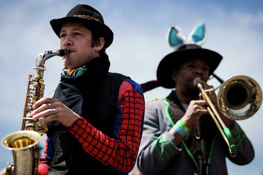 Brass players perform for crowds at the seventh annual HONK! Fest West in SeattleÕs Waterfront Park in Seattle, Wash. HONK! Fest's mission is to celebrate community music in public spaces with fanfare performances representing diverse musical influences. The festival ran from Friday through Sunday. Photo: JORDAN STEAD, SEATTLEPI.COM / SEATTLEPI.COM