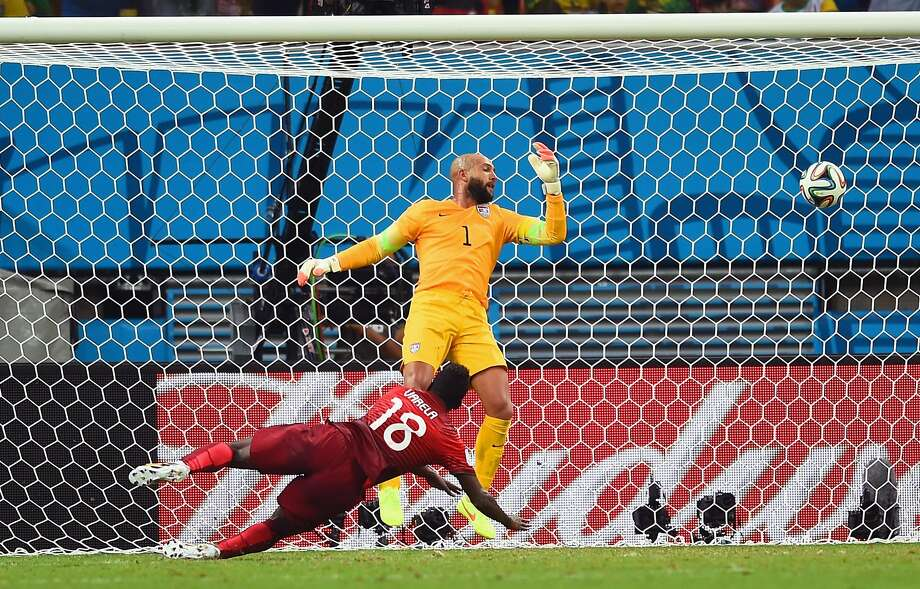 MANAUS, BRAZIL - JUNE 22:  Silvestre Varela of Portugal scores his team's second goal as goalkeeper Tim Howard of the United States looks on during the 2014 FIFA World Cup Brazil Group G match between the United States and Portugal at Arena Amazonia on June 22, 2014 in Manaus, Brazil.  (Photo by Christopher Lee/Getty Images) Photo: Christopher Lee, Getty Images