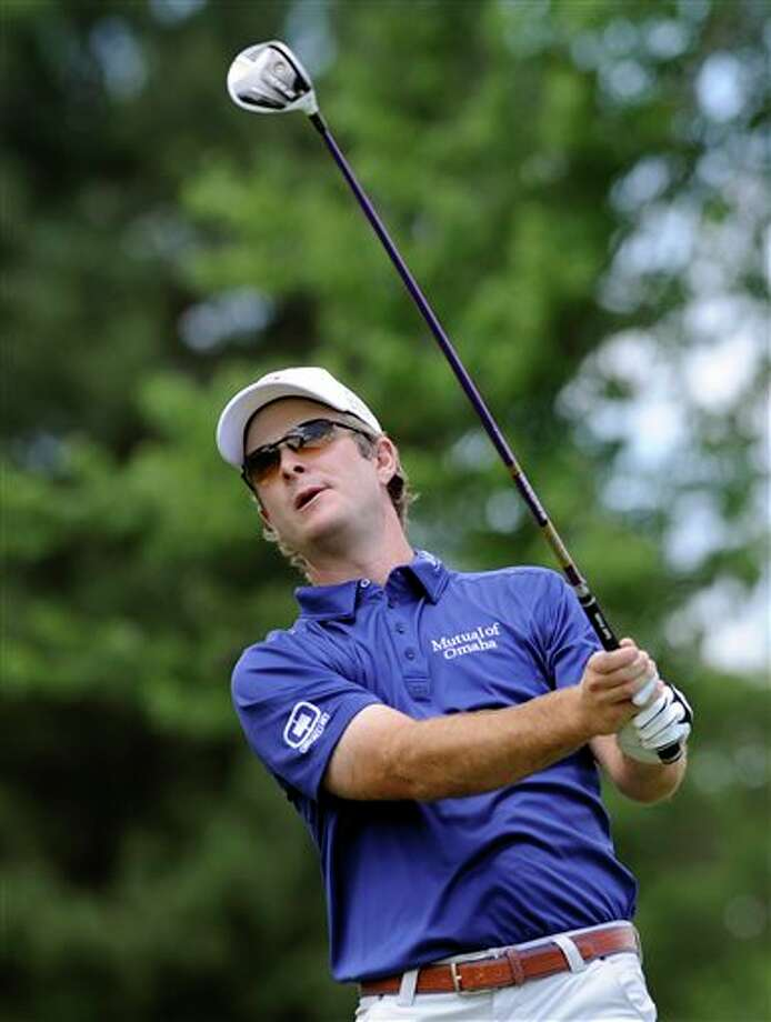 Kevin Streelman watches his drive on the second hole during the final round of theTravelers Championship golf tournament in Cromwell, Conn., Sunday, June 22, 2014. Streelman  finished his round with seven straight birdies to win the tournament at  15-under par. (AP Photo/Fred Beckham)