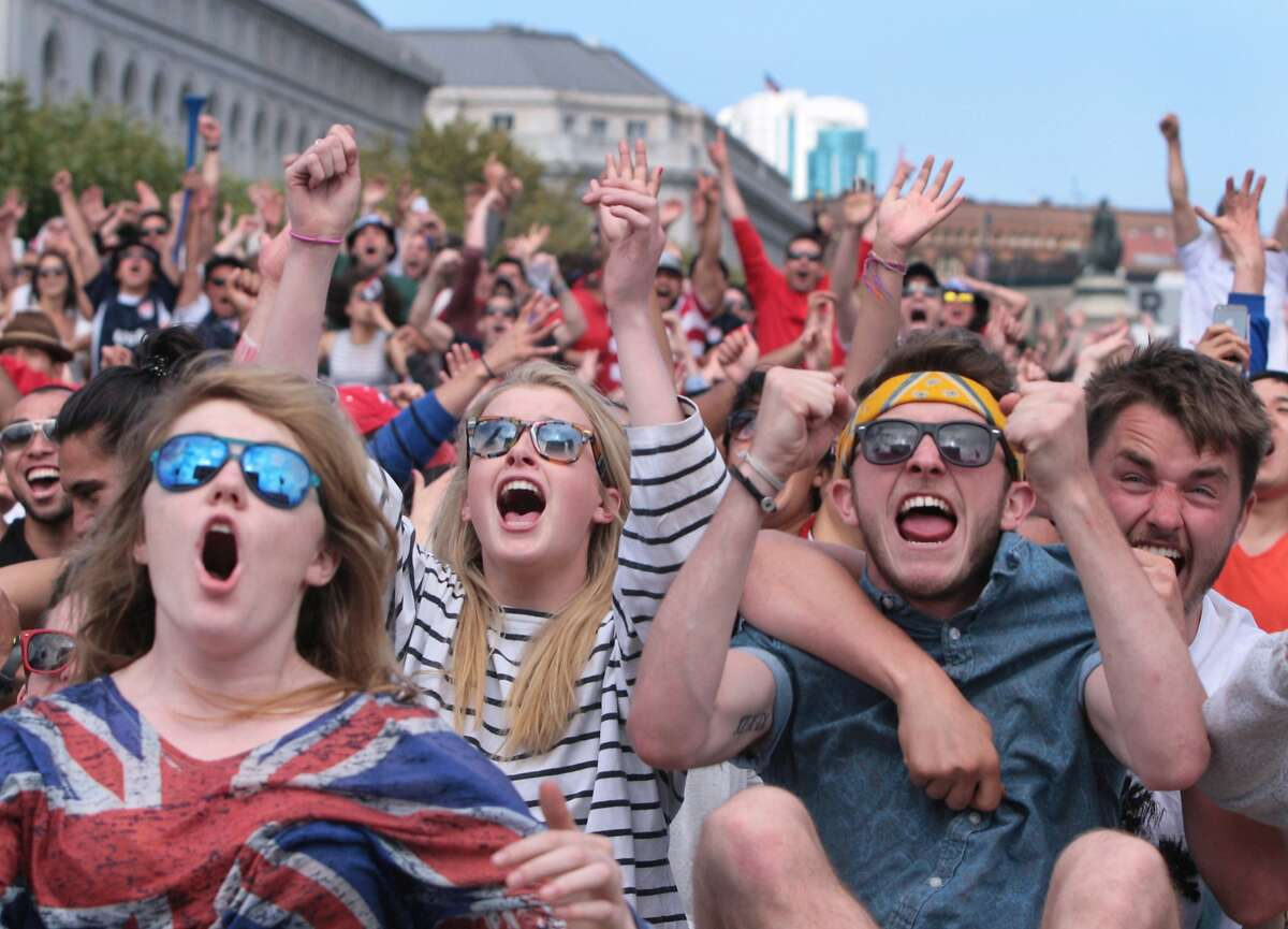 Sorcha O'Connor, left, Bronagh Dunne, middle, and Kevin Lynch (second from right) of Ireland react as the US scores its first goal against Portugal at a World Cup viewing party organized by the Recreation and Parks Department at Civic Center Plaza on Sunday, June 22, 2014 in San Francisco, Calif. The game would end in a 2-2 tie.