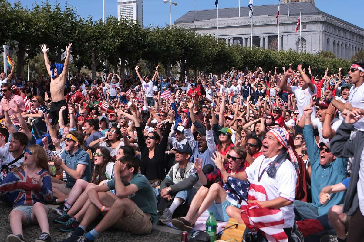 Fans cheer after the US soccer team scores its second goal against Portugal, putting them in the lead, at a World Cup viewing party organized by the Recreation and Parks Department at Civic Center Plaza on Sunday, June 22, 2014 in San Francisco, Calif. The game would end in a 2-2 tie.