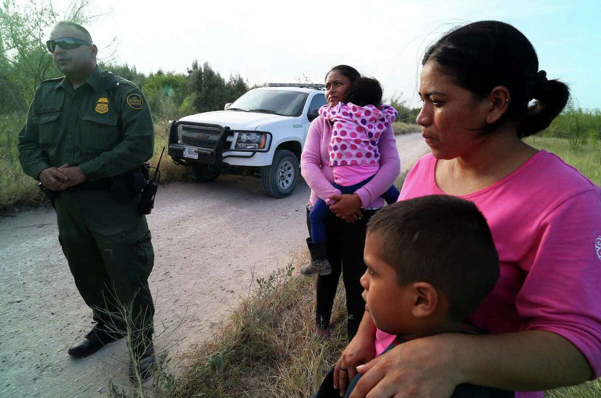 Border Patrol agents process migrants from Honduras and Guatemala, many of them women and children.