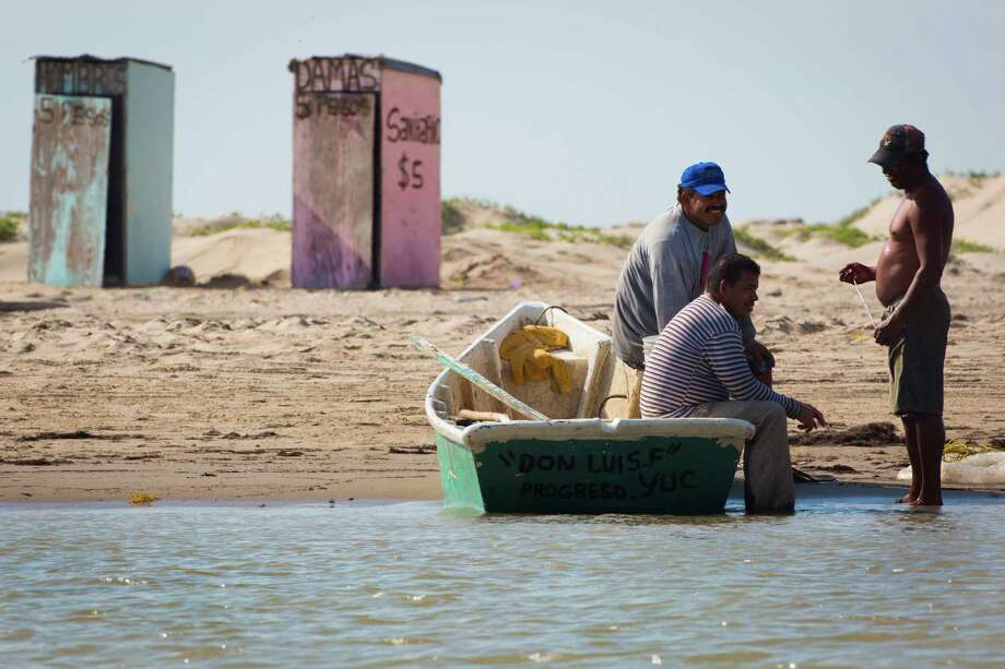 Fishermen rest on Wednesday on the Mexico coastline after fishing on the Rio Grande near the proposed location for the new commercial-mission-only SpaceX spaceport at Boca Chica. Photo: Marie D. De Jesus, Staff / © 2014 Houston Chronicle