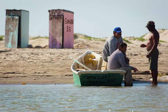 Fishermen rest on Wednesday on the Mexico coastline after fishing on the Rio Grande near the proposed location for the new commercial-mission-only SpaceX spaceport at Boca Chica.