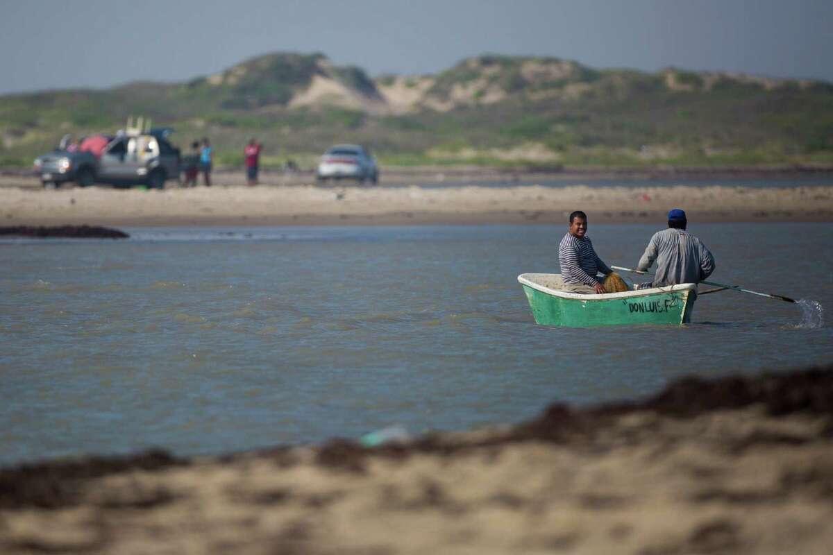 Fishermen cross the Rio Grande near the proposed spaceport location at Boca Chica.