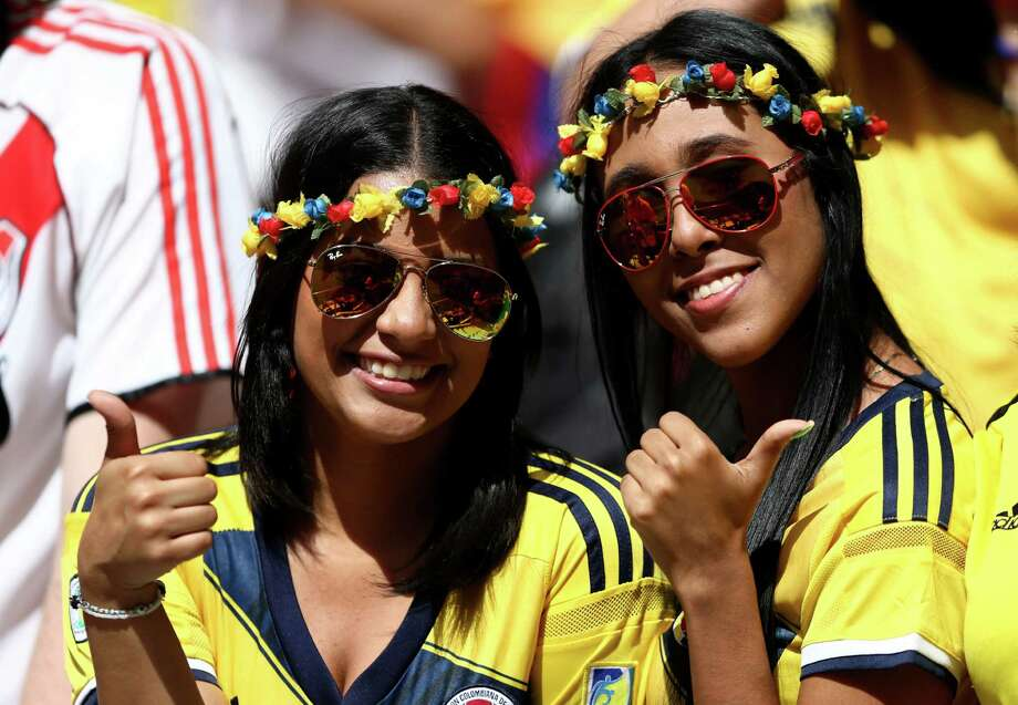 BRASILIA, BRAZIL - JUNE 19:  Colombia fans pose during the 2014 FIFA World Cup Brazil Group C match between Colombia and Cote D'Ivoire at Estadio Nacional on June 19, 2014 in Brasilia, Brazil. Photo: Warren Little, Getty Images / 2014 Getty Images