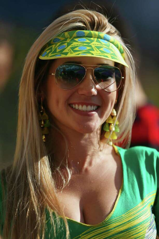 SAO PAULO, BRAZIL - JUNE 12:  A Brazil fan poses before the Opening Ceremony of the 2014 FIFA World Cup Brazil prior to the Group A match between Brazil and Croatia at Arena de Sao Paulo on June 12, 2014 in Sao Paulo, Brazil. Photo: Warren Little, Getty Images / 2014 Getty Images