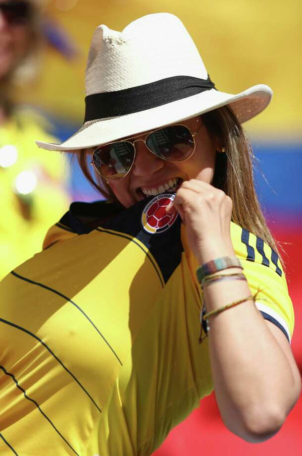 BRASILIA, BRAZIL - JUNE 19:  A Colombia fan enjoys the atmosphere prior to the 2014 FIFA World Cup Brazil Group C match between Colombia and Cote D'Ivoire at Estadio Nacional on June 19, 2014 in Brasilia, Brazil. Photo: Warren Little, Getty Images / 2014 Getty Images