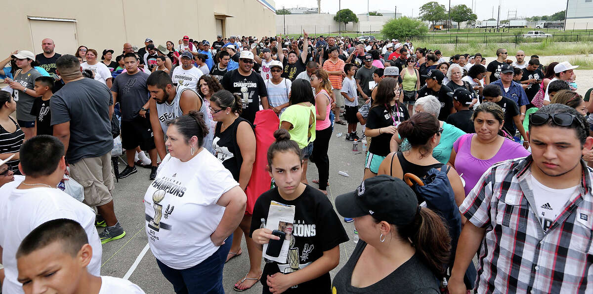 Spurs fans wait outside Academy for autographs from Tony Parker and photos with the Larry O'Brien NBA Championship Trophy Sunday June 22, 2014.