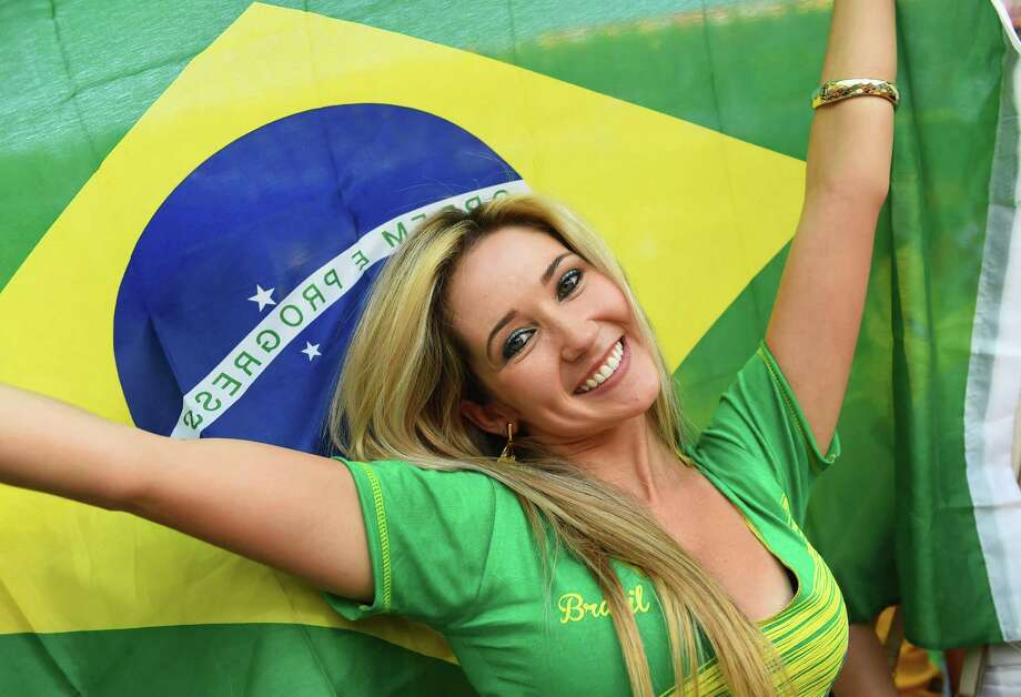 SAO PAULO, BRAZIL - JUNE 12:  A fan waves a Brazilian flag during the 2014 FIFA World Cup Brazil Group A match between Brazil and Croatia at Arena de Sao Paulo on June 12, 2014 in Sao Paulo, Brazil. Photo: Christopher Lee, Getty Images / 2014 Getty Images