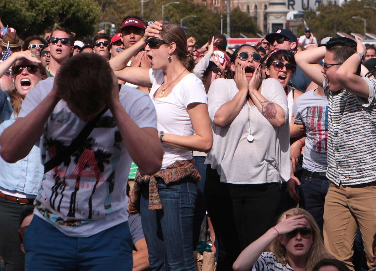 Fans react after Portugal scores a last-minute goal against the US soccer team, ending the game in a tie at a World Cup viewing party organized by the Recreation and Parks Department at Civic Center Plaza on Sunday, June 22, 2014 in San Francisco, Calif.