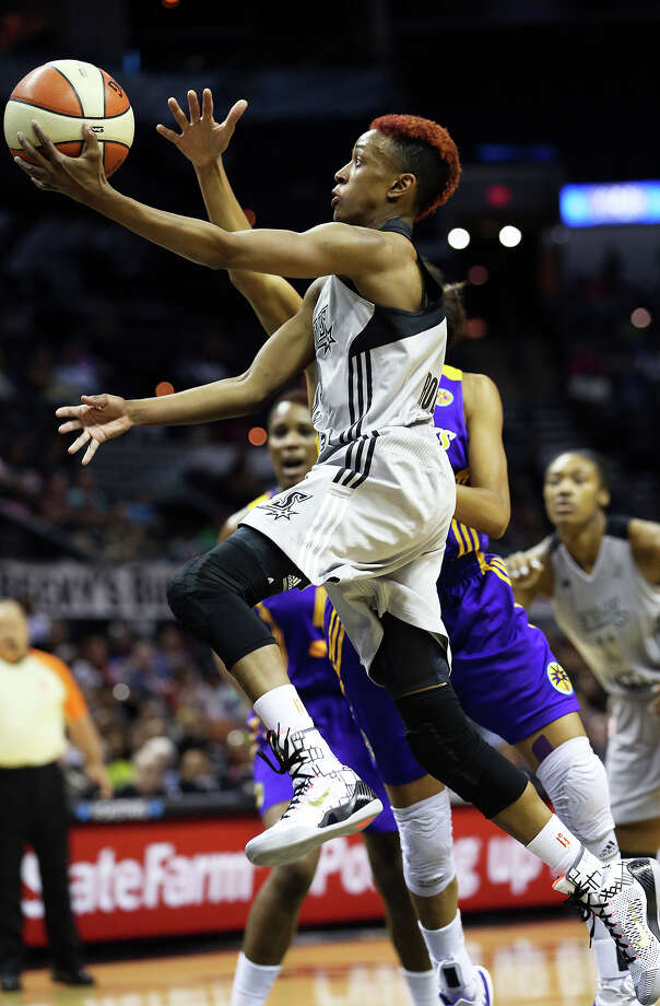 Danielle Robinson darts to the bucket for a quick layup in the first half as the Stars play the Los Angeles Sparks at the AT&T Center on June 14, 2014. Photo: For The San Antonio Express-News