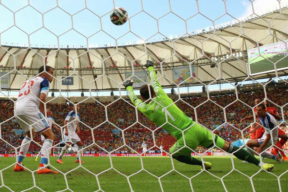 RIO DE JANEIRO, BRAZIL - JUNE 22:  Divock Origi of Belgium scores his team's first goal past Igor Akinfeev of Russia during the 2014 FIFA World Cup Brazil Group H match between Belgium and Russia at Maracana on June 22, 2014 in Rio de Janeiro, Brazil.  (Photo by Julian Finney/Getty Images) ORG XMIT: 491716543 Photo: Julian Finney / 2014 Getty Images