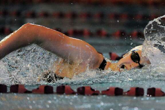 Katie Ledecky finds the Conroe ISD Natatorium to her liking again Sunday, speeding to a world record in the 800-meter freestyle after setting the 1,500 record on Thursday. Ledecky naturally finds the time to her liking, below.