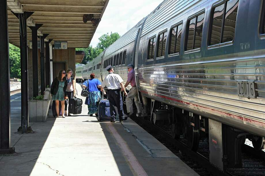 Passengers exit and board an Amtrak train from Albany at the Schenectady Train Station Thursday, June 19, 2014 in Schenectady, N.Y. This train was headed north towards Montreal. (Lori Van Buren / Times Union) Photo: Lori Van Buren / 00027443A