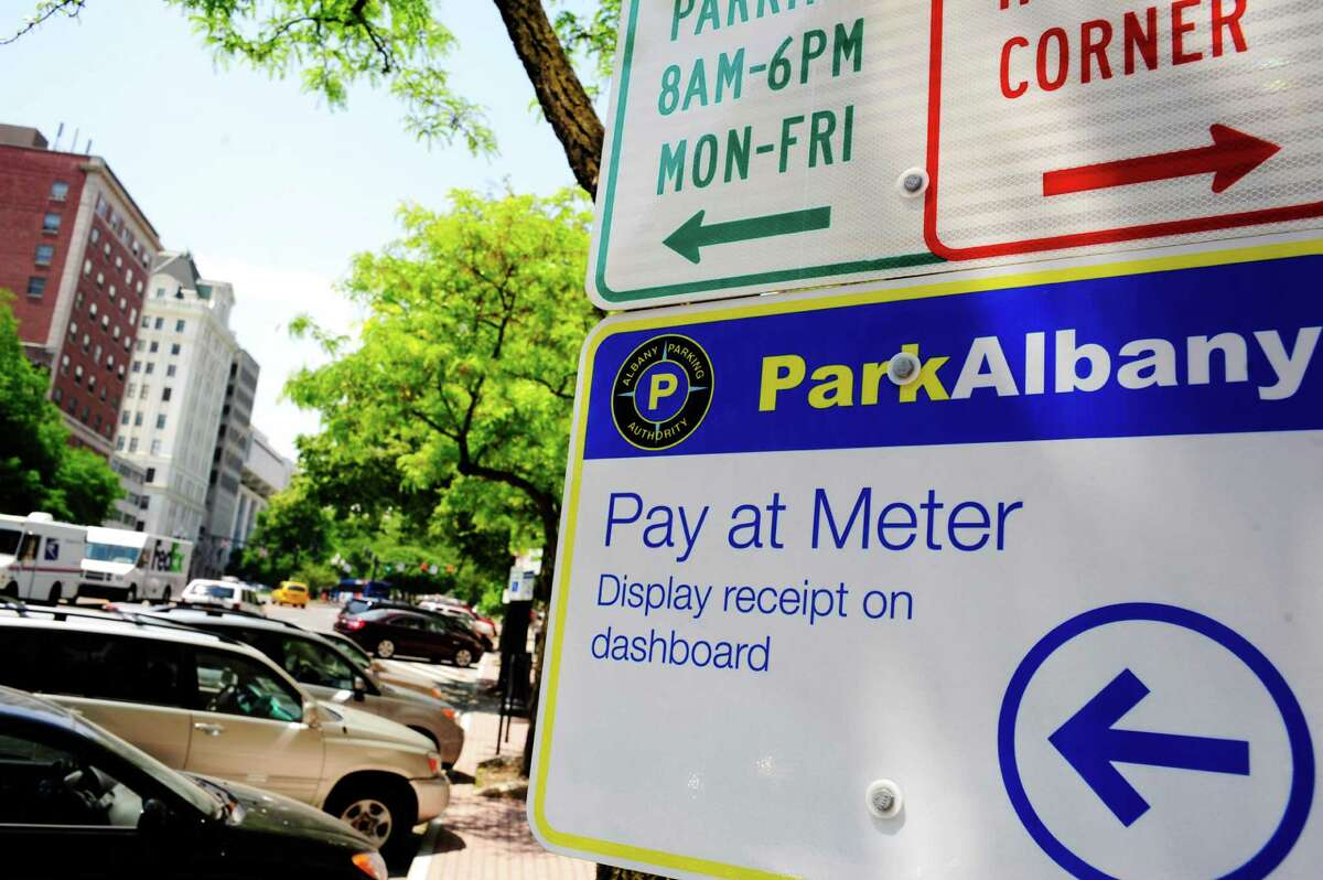 A sign directs people where to pay for parking along State St., seen here on Tuesday, June 3, 2014, in Albany, N.Y. (Paul Buckowski / Times Union)