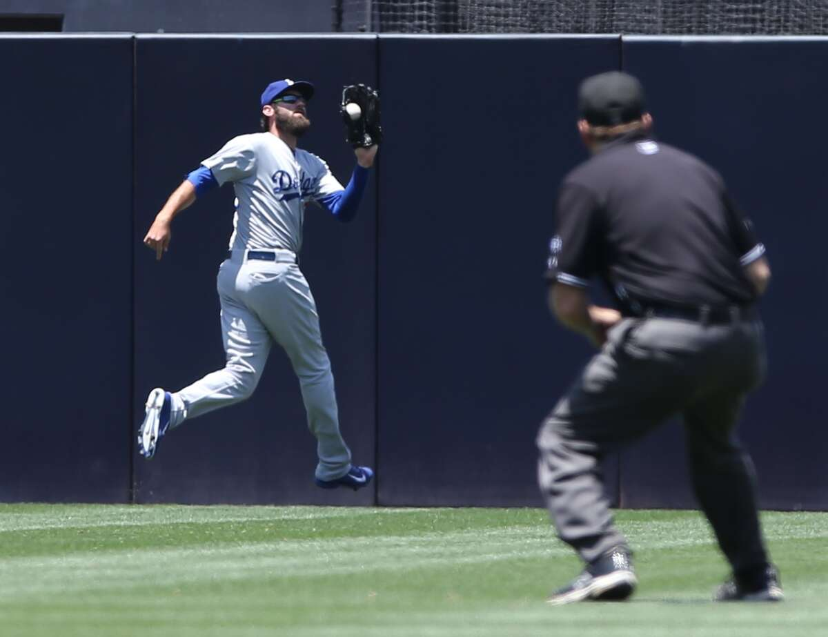 Los Angeles Dodgers center fielder A.J. Ellis makes the out on San Diego Padres' Carlos Quentin to end the first inning during a baseball game Sunday, June 22, 2014, in San Diego. (AP Photo/Don Boomer) ORG XMIT: CADB108