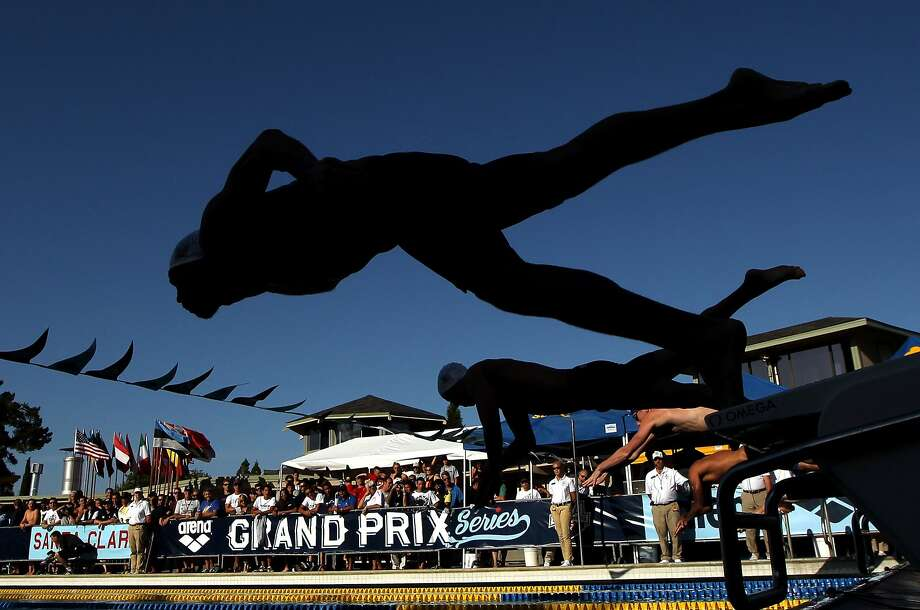 Michael Phelps dives into his first 200 individual medley since his 2012 gold-medal performance. Photo: Ezra Shaw, Getty Images