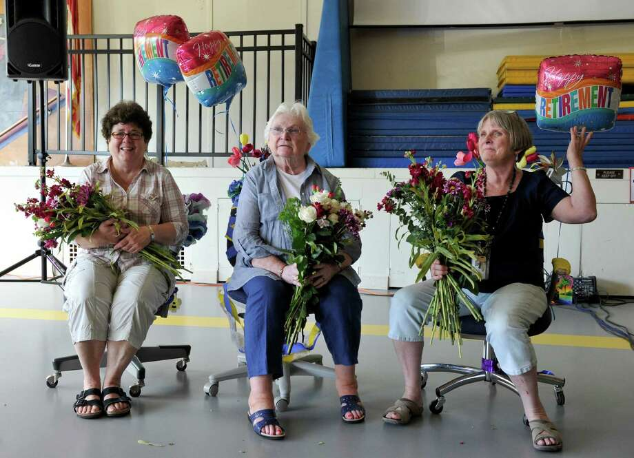 Center Elementary School in Brookfield, Conn., celebrated three retiring teachers during an all-school assembly Wednesday morning that included a procession of children with flowers, songs and dancing. The teachers are, from left, Judy Williams, a kindergarten teacher who has been in the district 44 years, and Joan Oppenheimer and Toni Sullivan, first grade teachers with 29 years in the district. Photo: Carol Kaliff / The News-Times