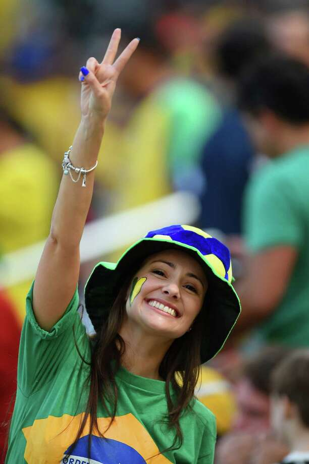 CURITIBA, BRAZIL - JUNE 16: A fan cheers during the 2014 FIFA World Cup Brazil Group F match between Iran and Nigeria at Arena da Baixada on June 16, 2014 in Curitiba, Brazil. Photo: Matthias Hangst, Getty Images / 2014 Getty Images