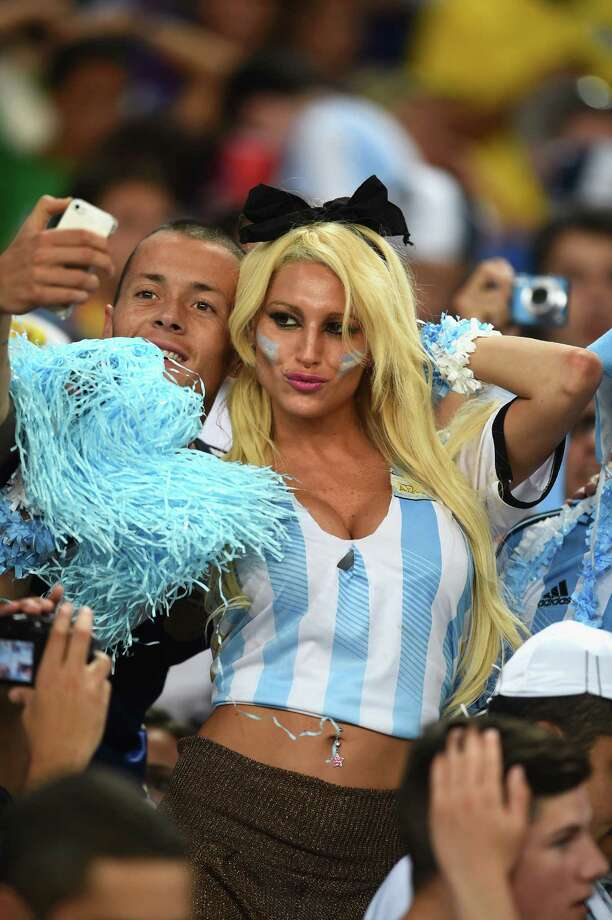 RIO DE JANEIRO, BRAZIL - JUNE 15: Argentina fans take a selfie in the crowd prior to the 2014 FIFA World Cup Brazil Group F match between Argentina and Bosnia-Herzegovina at Maracana on June 15, 2014 in Rio de Janeiro, Brazil. Photo: Matthias Hangst, Getty Images / 2014 Getty Images