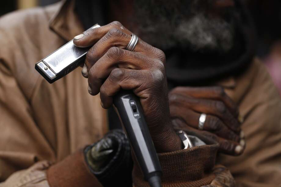 "Delta blues harmonica player Vincente ""Blue"" Blupriest preps his Hohner harmonica at the Powell Street cable car turnaround in San Francisco, Calif. Photo: Mike Kepka, The Chronicle"
