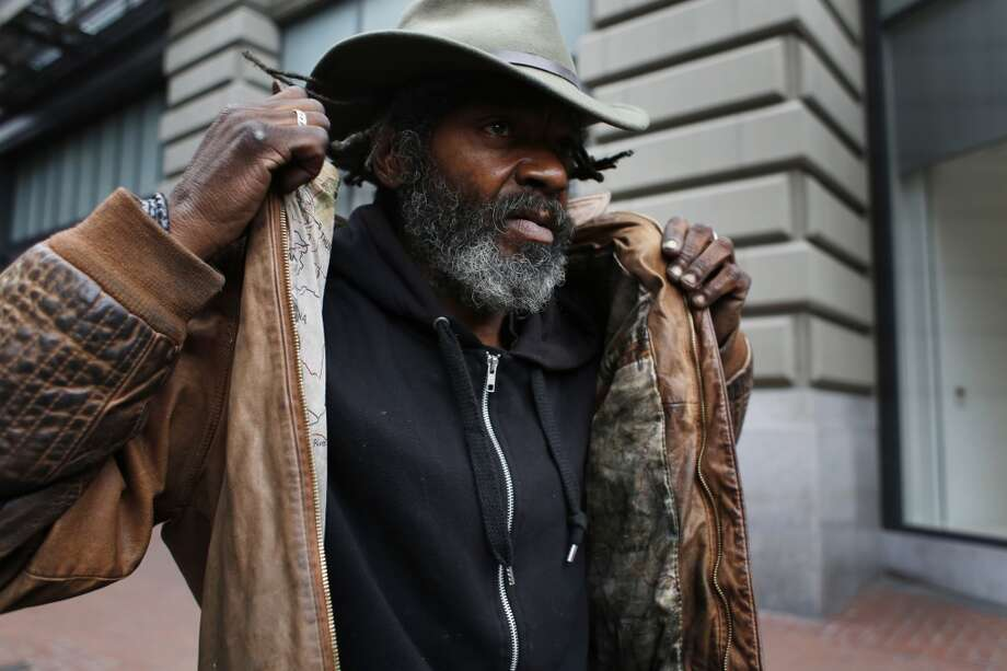 "Delta blues harmonica player Vincente ""Blue"" Blupriest packs up for the morning after playing a 45 minute set at the Powell Street cable car turnaround in San Francisco. Photo: Mike Kepka, The Chronicle"