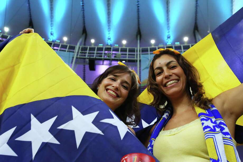 RIO DE JANEIRO, BRAZIL - JUNE 15:  Bosnia and Herzegovina fans hold flags prior to the 2014 FIFA World Cup Brazil Group F match between Argentina and Bosnia-Herzegovina at Maracana on June 15, 2014 in Rio de Janeiro, Brazil. Photo: Ronald Martinez, Getty Images / 2014 Getty Images