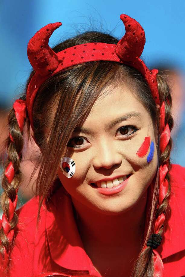 PORTO ALEGRE, BRAZIL - JUNE 22:  A South Korea fan with a painted face cheers prior to the 2014 FIFA World Cup Brazil Group H match between South Korea and Algeria at Estadio Beira-Rio on June 22, 2014 in Porto Alegre, Brazil. Photo: Ian Walton, Getty Images / 2014 Getty Images